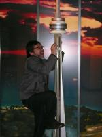 CN TOWER in Toronto…me tyring to climb up a miniature version of it, just the right size/height for me!!!