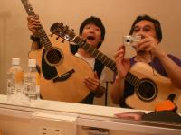"""Me and Akihiro Tanaka in the dressing room of """"Mojo West"""" in Kyoto on 8/8/09. Aki is a young guitarist full of promise."""